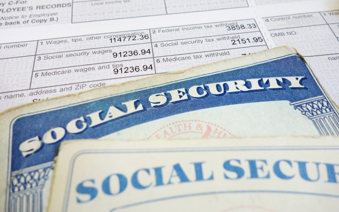 Social Security card on top of employee tax forms.